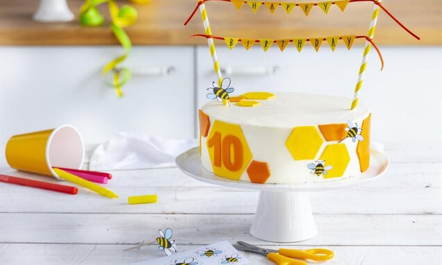 bee cake with pennants